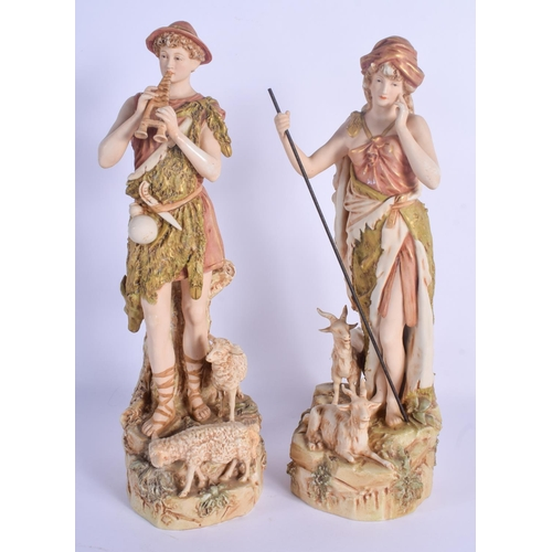 298 - A LARGE PAIR OF ROYAL DUX PORCELAIN FIGURES modelled seated beside sheep and goats. 38 cm high....