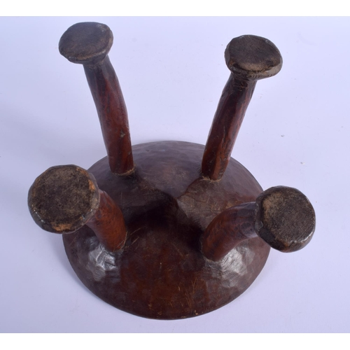 355 - A LOVELY EARLY 20TH CENTURY AFRICAN TRIBAL FOUR FOOTED STOOL with animal like feet. 25 cm x 23 cm....