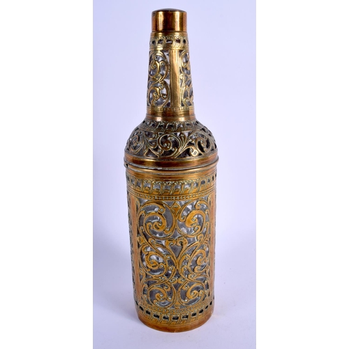 357 - AN EARLY 20TH CENTURY INDIAN BRASS OVERLAID GLASS BOTTLE decorated with foliage and vines. 29 cm hig...