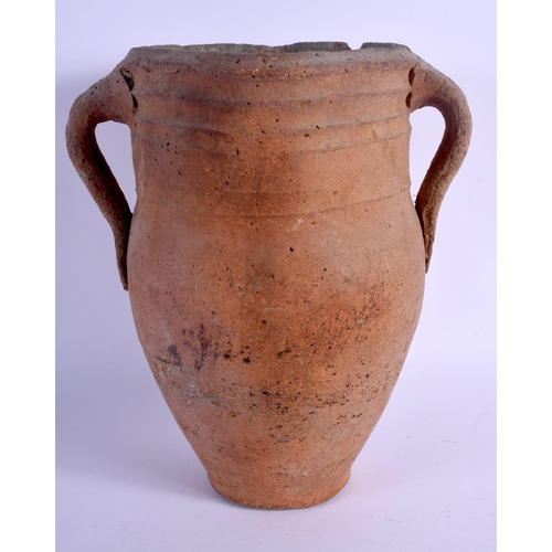 362 - A MIDDLE EASTERN IRANIAN 10TH CENTURY POTTERY VASE. 30 cm high....