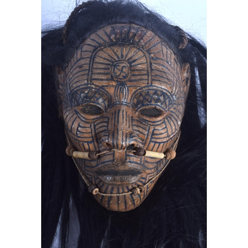379 - AN UNUSUAL TRIBAL CARVED AND LACQUERED HEAD OF A LEADER possibly Maori or South American, with tatto...