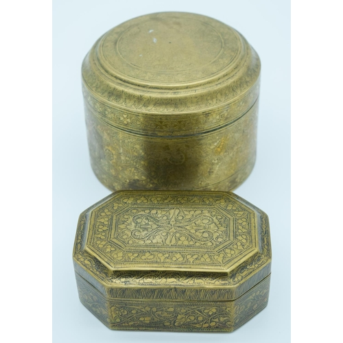 4008 - Two Indian 19th century engraved brass boxes largest 9.5cm x 13 cm. (2)...
