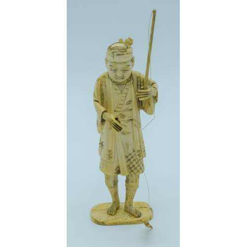 4019 - A small Japanese Meiji Period Ivory figure of a fisherman 20cm ....
