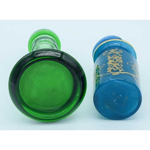 4023 - A Middle Eastern glass vase together with a   blue vase and a stopper 23cm . (3)...