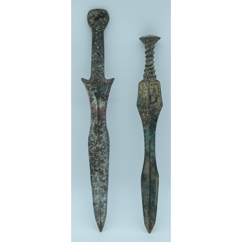 4033 - Two Chinese bronze swords 38cm (2)....