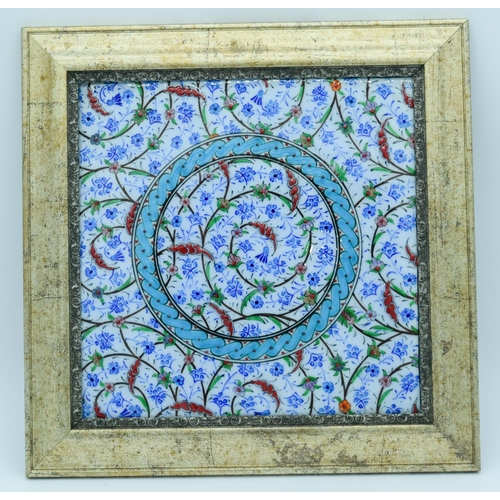 4036 - A  framed Islamic tile 24 x 24 cm....