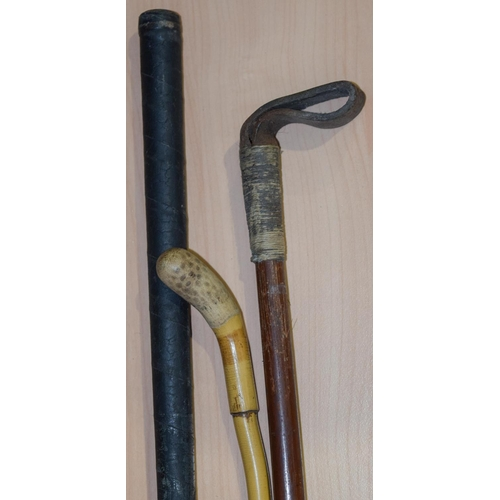 4042 - A vintage hickory shaft Golf club and two horse whips 92cm (3)....