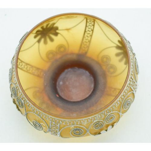 4077 - A small Middle Eastern glass bowl with white metal decorations 13 x 6 cm....