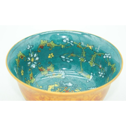 4088 - A small Chinese bowl decorated with Dragons 7.5 x 12.5cm....