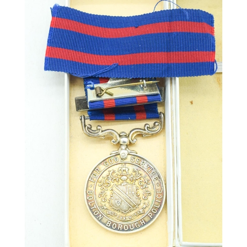 4094 - Bolton Police 1943 silver medal, Truncheon and Whistle (3)....