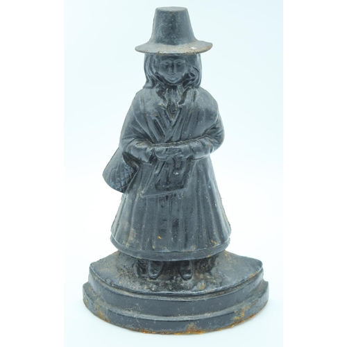 4130 - Vintage cast iron door stop in the form of a Welsh woman 33cm....