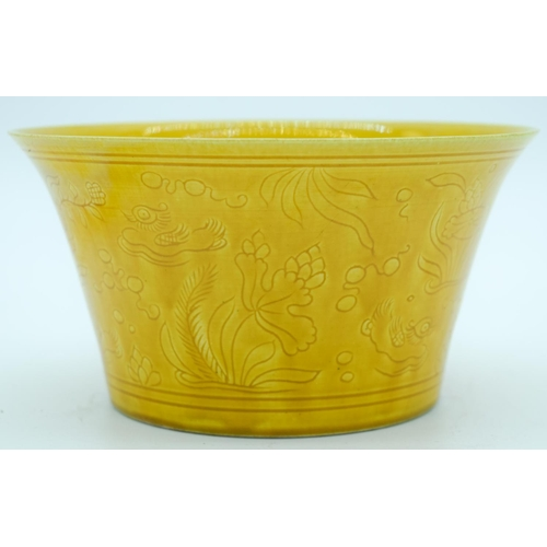 4144 - A Chinese yellow ground bowl decorated with lotus 16.5 x 8.5cm ....