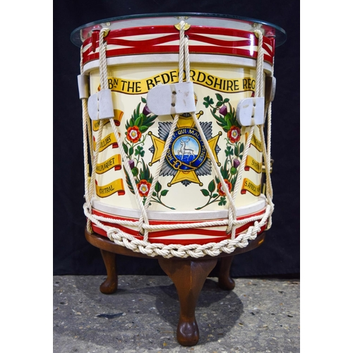 4155 - A Bedford Regiment Drum by George Potter converted to a glass topped table 54 x 42....