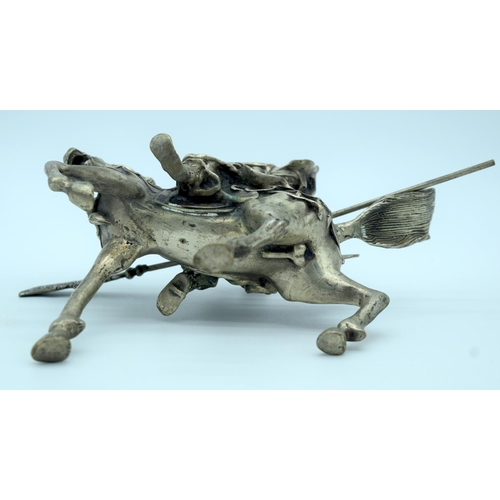 4202 - A white metal Guangon rider on a horse 18 x 23 cm....