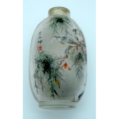 4204 - A reverse painted snuff bottle birds in foliage 7 x 4 cm....