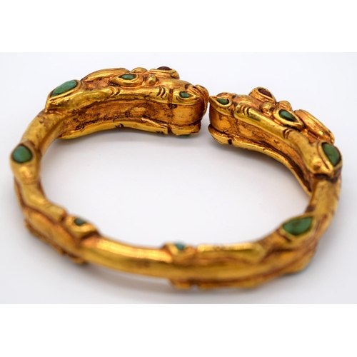 4207 - A Chinese yellow metal dragon bracelet inlaid with turquoise stones 7.5 x 6.5cm...