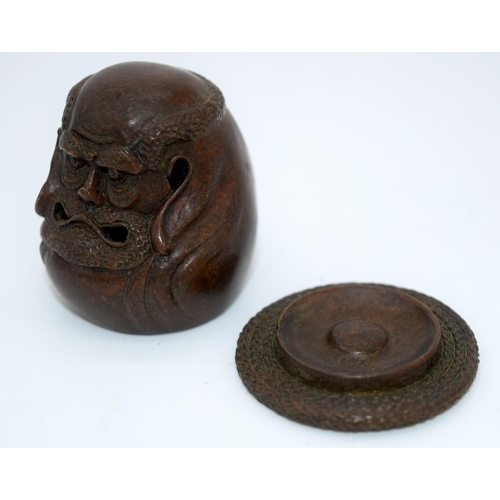 4239 - A Japanese small bronze figure of a grotesque head  12cm (2)....