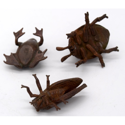 4248 - A Japanese small bronze Scarab together with a frog and a fly 6cm (3)....