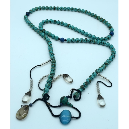 4270 - A long Turquoise stone necklace with hanging glass pendants 170cm....