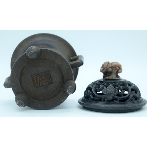4278 - A 19th century bronze incense burner  with a carved wooden and soapstone lid 17 x 14cm...