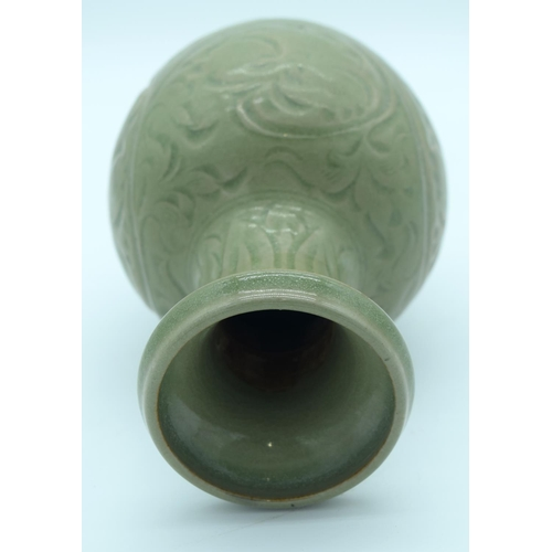 4342 - A Chinese green glazed vase with a floral pattern 24 x 13cm....