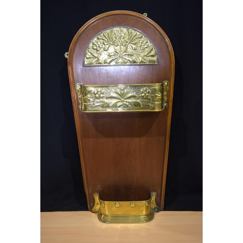 4357 - A  wooden and embossed brass hanging stick/umbrella stand 96 x49cm....