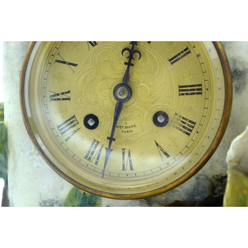 4361 - A large continental ceramic flower encrusted Henry Marc clock ....