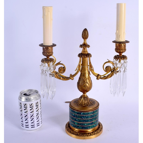 501 - A MID 19TH CENTURY FRENCH MALACHITE AND ORMOLU CANDELABRA upon acanthus capped bases. 30 cm x 22 cm ...