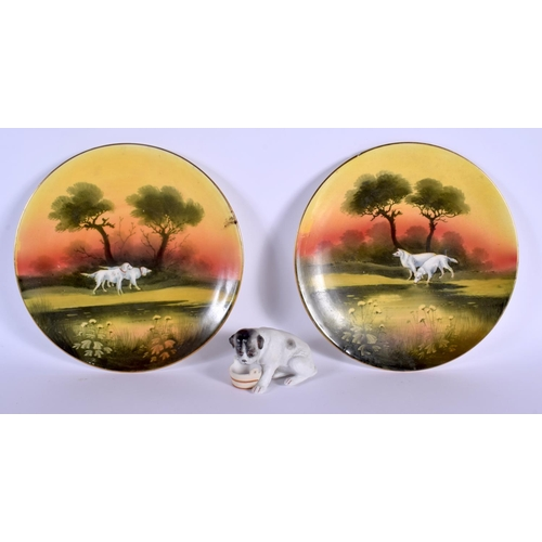 52 - A RARE PAIR OF ROYAL ALBERT PORCELAIN DOG PLATES together with a bisque figure of a dog. Plate 21 cm...
