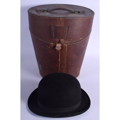 522 - AN ANTIQUE LEATHER CASED WILSON BOWLER HAT. Hat interior 21 cm x 14 cm. (2)...