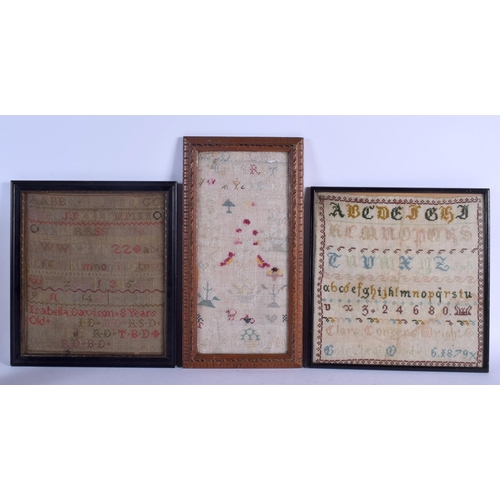 524 - THREE 19TH CENTURY FRAMED EMBROIDERED SAMPLERS. Largest sampler 30 cm square. (3)...