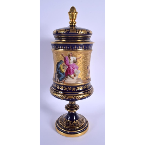 54 - A LARGE EARLY 20TH CENTURY VIENNA PORCELAIN PEDESTAL VASE painted with classical scenes. 38 cm high.