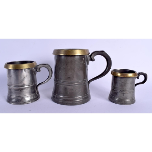 540 - THREE LARGE 19TH CENTURY PEWTER IMPERIAL MEASURE SHIPS HOTEL MARITIME MUGS. Largest 18 cm high. (3)...