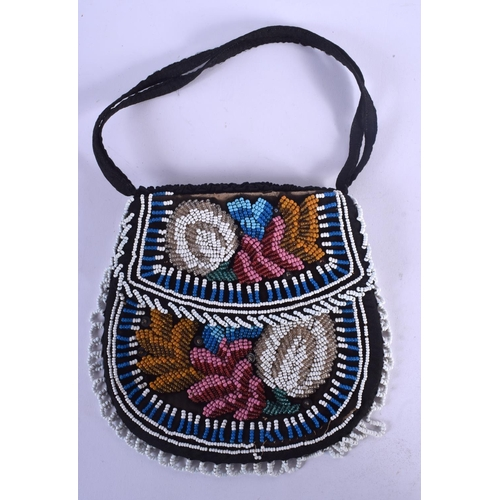541 - A VINTAGE AMERICAN INDIAN BEADWORK PURSE possibly C1880. 17 cm x 15 cm....