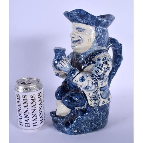 55 - AN ANTIQUE DUTCH BLUE AND WHITE DELFT POTTERY TOBY JUG modelled as a male holding an ale jug. 27 cm ...