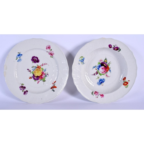 56 - TWO 18TH CENTURY CONTINENTAL PORCELAIN PLATES painted with flowers under a wrythen moulded border. 2...