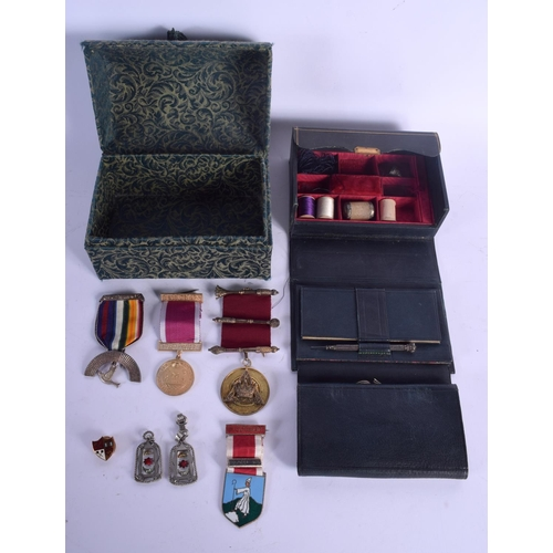 561 - AN UNUSUAL LEATHER CASED THIMBLE BOX together with a dome top casket containing medals. (qty)...