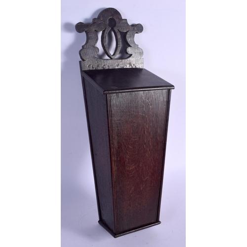 562 - AN ANTIQUE OAK CANDLE BOX. 47 cm x 15 cm....