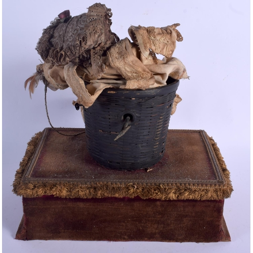 571 - AN UNUSUAL ANTIQUE EUROPEAN PAPIER MACHE AND VELVET AUTOMATON TOY modelled as a girl within a basket...