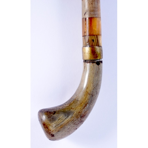 576 - A 19TH CENTURY CONTINENTAL FULL LENGTH RHINOCEROS AND BUFFALO HORN WALKING CANE. 88 cm long....
