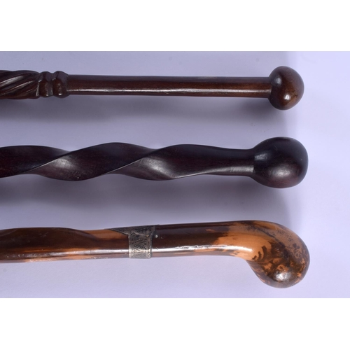 579 - AN ANTIQUE WALKING CANE and two others. 95 cm long. (3)...