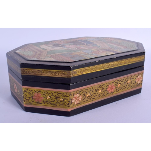 591 - A 19TH CENTURY MIDDLE EASTERN PERSIAN QAJAR LACQUER BOX AND COVER painted with figures. 22 cm x 13 c...