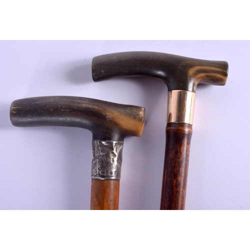 596 - TWO 19TH CENTURY CONTINENTAL CARVED RHINOCEROS HORN HANDLED WALKING CANES. 88 cm long. (2)...