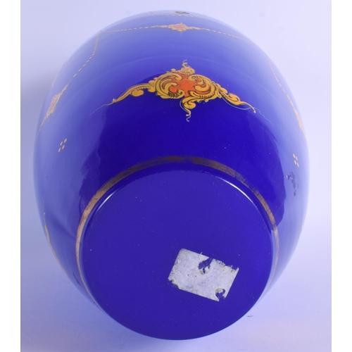 6 - A LARGE TURKISH OTTOMAN BLUE GLASS VASE enamelled with motifs. 39 cm x 18 cm....