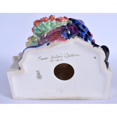 60 - A RARE LARGE ROYAL DOULTON FIGURE OF THE FLOWER SELLERS CHILDREN HN 1342. 24 cm x 16 cm....