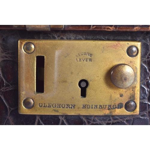 606 - AN ANTIQUE LEATHER CARRYING CASE Cleghorn Edinburgh. 39 cm x 28 cm....