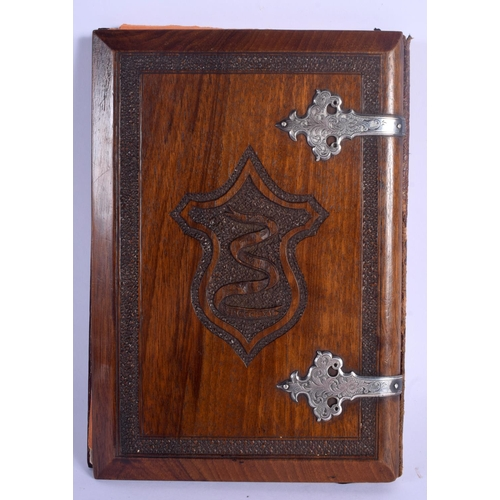 609 - AN ANTIQUE MIDDLE EASTERN CARVED WOOD BLOTTER with silver mounts. 21 cm x 18 cm....