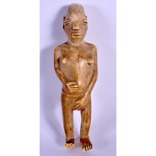 659 - A 19TH CENTURY AFRICAN TRIBAL CARVED IVORY FIGURE OF A FEMALE possibly a medicine doll. 18 cm high....