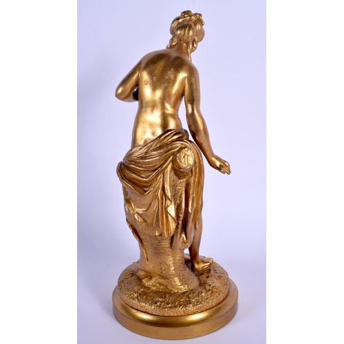 660 - A 19TH CENTURY EUROPEAN IVORY GILT BRONZE FIGURE OF A NUDE FEMALE modelled holding a bird. 24 cm hig...