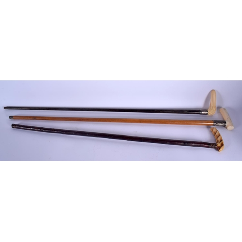 663 - THREE 19TH CENTURY CARVED IVORY HANDLED WALKING CANES. 90 cm long. (3)...